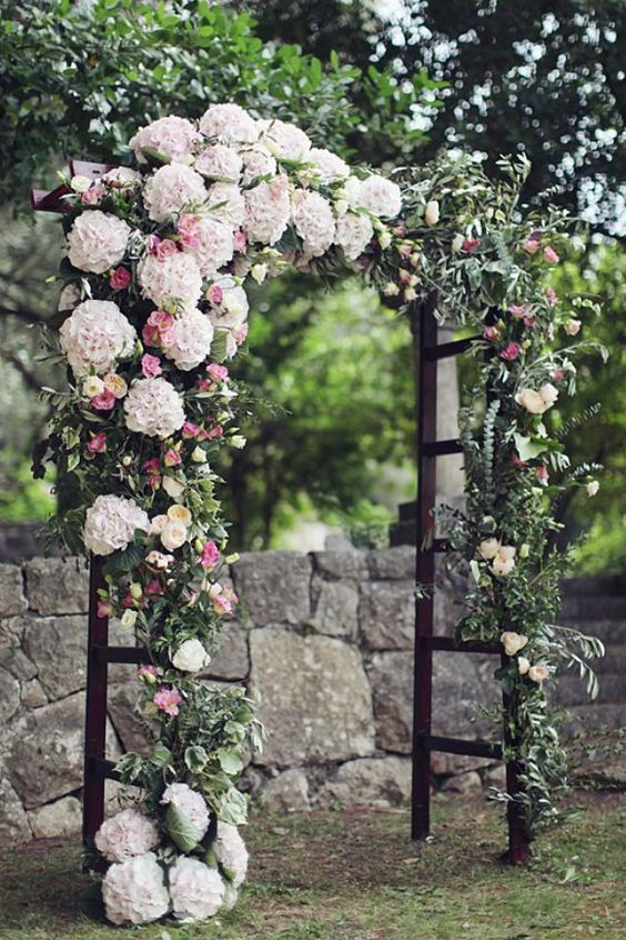 Photographer: Sonya Khegay; Elegant pink and white floral wedding ceremony chuppah;