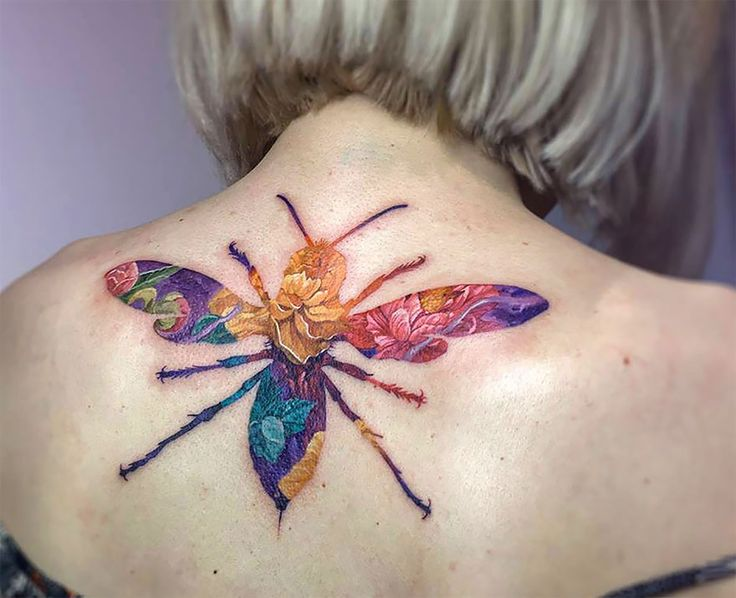 Double exposure photography is not a new thing but what about double exposure tattoos? Wroclaw-based Polish tattoo artist Andrey Lukovnikov is doing just that! Lukovnikov merges together ordinary insects with flowers and the result is beyond gorgeous!