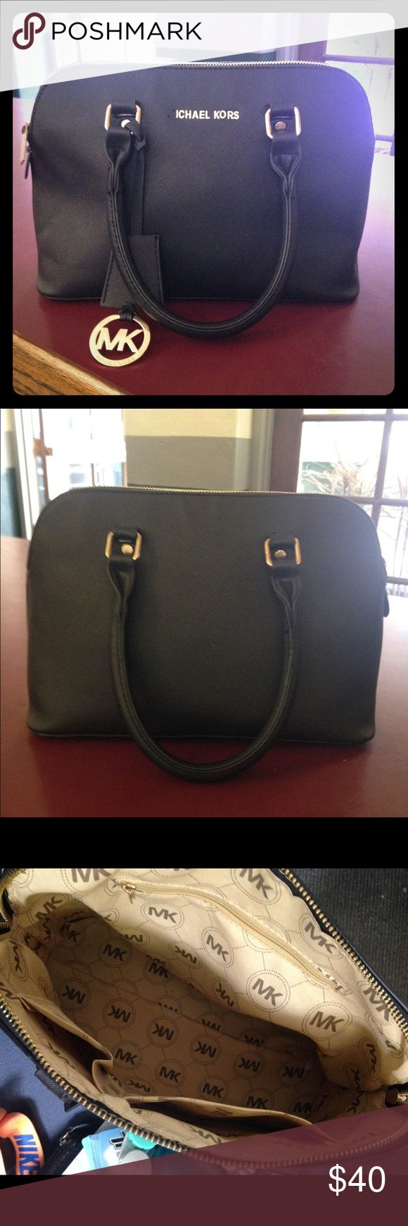Medium black Michael Kors Purse Best bag I've ever had. Great overall condition however does have damage as seen in photos. Seems to one handle are coming loose and unfortunately the M of Michael has fallen off. Just don't have the time to fix or keep anymore. Rest of the bag is in great condition no other damages, stains, or rips. Am willing to negotiate. Make an offer:) Michael Kors Bags Shoulder Bags