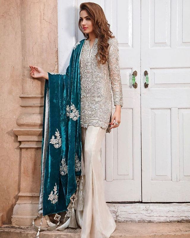 Make a statement this festive season in an all-silver outfit teamed with an embellished teal velvet shawl #RemaShehrbano