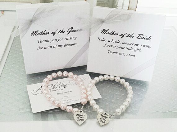 This listing is for TWO Mothers Bracelets made with a simple strand of Swarovski Pearls, in the pearl color of your choice. This set comes