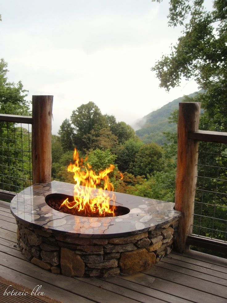 fabulous log cabin porch with a cozy firepit asheville nc