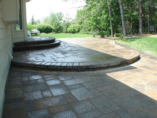 multi level patios such as this glazed stone one give an unexpected treat for the - Multi Level Patio Designs