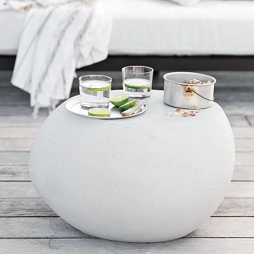 """Pebble Side Table #WestElm - Inspired by smooth river rocks, the Pebble Side Table is a charming spot to rest drinks, trays and books when you're lounging outside. • Cement concrete • 23""""w x 15""""d x 14""""h • $149"""