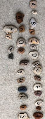 """The Activity Mom simply uses a Sharpie pen to create her alphabet stones ("""",)"""