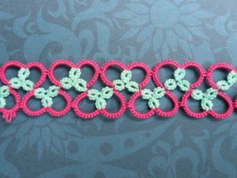 """Nice effect with two colors, tatting heart pattern, here it is: R4-4, C6-11, R4+4, C11-6, R4+4 rw R4-4 (here I made the join by wrapping the thread around the thread that is between the two small rings so that there is pink on both sides), C6-11 and so on. I've not put all the """"RWs"""" in there but I think it's pretty well self-explanatory."""