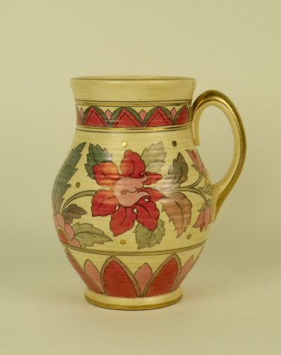 A Charlotte Rhead for Crown Ducal single handled vase, post 1940, decorated with pattern 6778, with pink flowers and silver-green foliage against a cream ground, printed marks and painted pattern number, 25.5cm high.