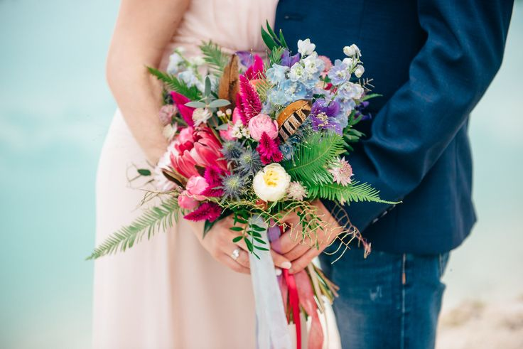 Boho hand tied bouquet of protea, peony, astrantia, clematis, eryngium, celosia, spray roses, dahlia, david austin roses, eucalyptus
