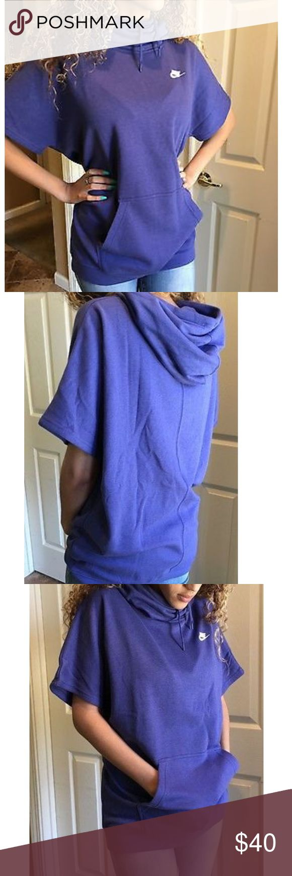 Nike short sleeve hoodie size M*NEW* No trade New*women's Nike Purple hoodie is warm with brushed back fleece and hits mid thigh for ultimate comfort.  The color is a purple-ish blue, the picture with the model is just to show fit.   Attached drawcord hood Cowlneck Cotton, rayon, polyester Nike Tops Sweatshirts & Hoodies