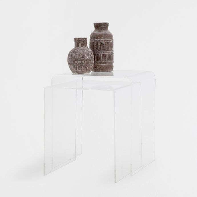 Nest of transparent acrylic resin tables. Sold in a set of 2. <br><br>The small table measures 12.2x11.8x13.8 in and the large table 13x14.4x15.7 in.