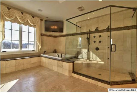 I want a huge bathroom like this with a TV above the tub and a huuuge shower