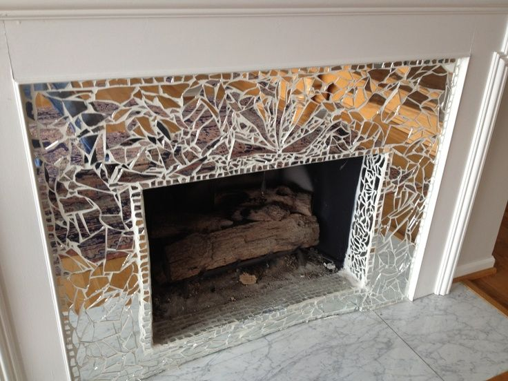 Decorated fireplace with a broken mirror
