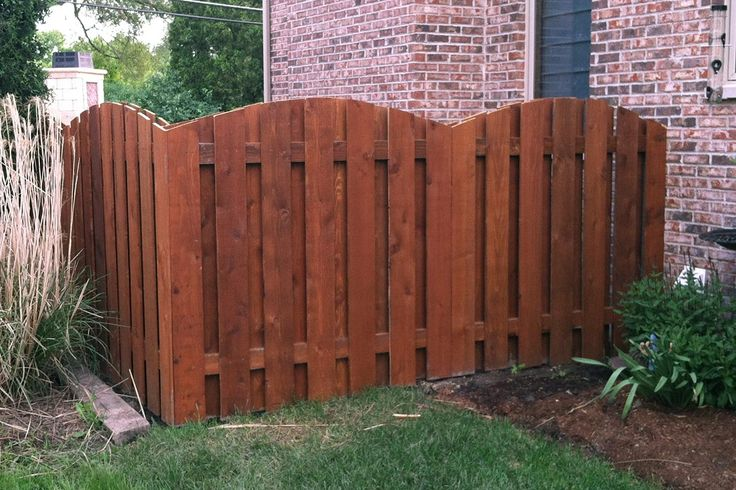 Board on board, otherwise known as shadowbox, arched wood fence. Stained and installed by First Fence Company in Hillside, IL