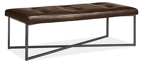 Our leather Sidney ottoman offers a classic look with a modern twist. Its intersecting steel base adds modern flair to the tufted cushion top. Use this ottoman as a place to put up your feet, set your book or as extra seating anywhere in your home. The flexibility and function that Sidney offers is matched by its comfort and style.