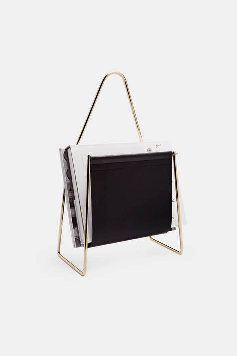 The fourth-generation Viennese workshop of Carl Auböck combines traditional craftsmanship with modern design. Designed in the 1950s by Carl Auböck II (1900–1957), this modern accent piece suspends an expanse of black leather from a lustrous brass frame. The resulting sling creates a place to keep magazines, newspapers, or a book or two close at hand.