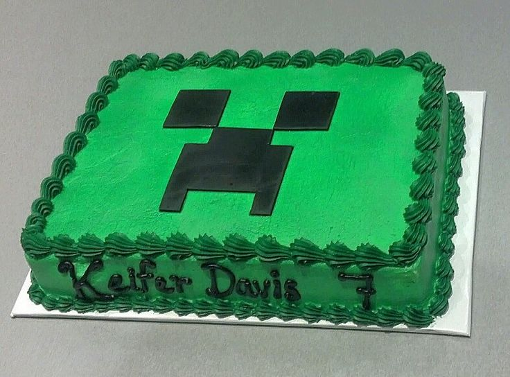 Order a plain green cake and make the creeper face out of black fondant! Easy!