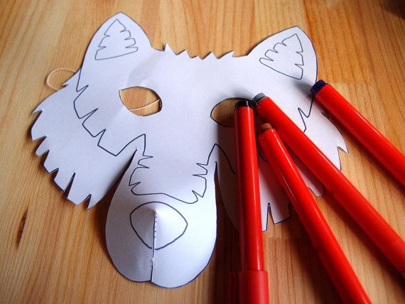 Wolf Mask The wolf prowls through the night on nimble paws. Imagine youre a wolf: pad silently on all fours, throw back your head and howl at