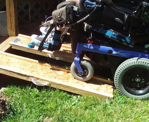 "Wheelchair ramp made with wood joists and ramp ends. Would need to be 10' each to meet 2:12"" standards for our garage entry"