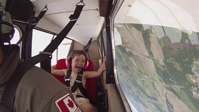 """""""Papa, I want my head upside down again!"""" A Quebec father and his young daughter share an amazing first aerobatic flight together."""