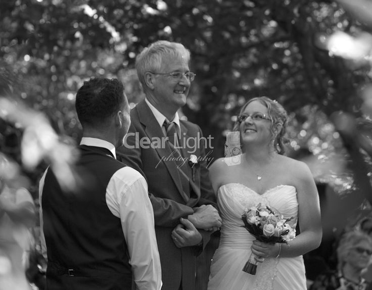 Such a lovely father/daughter moment with groom looking on.