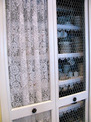 Maybe the lace in front  of the doors on the small wall cabinet I have?