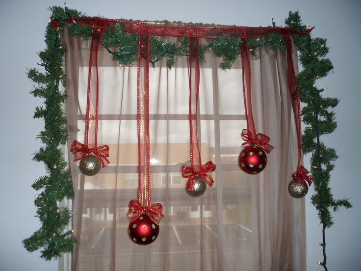 Decorating idea--Christmas balls and ribbon in the window!  Easy tutorial--only needs 3 items to make :)