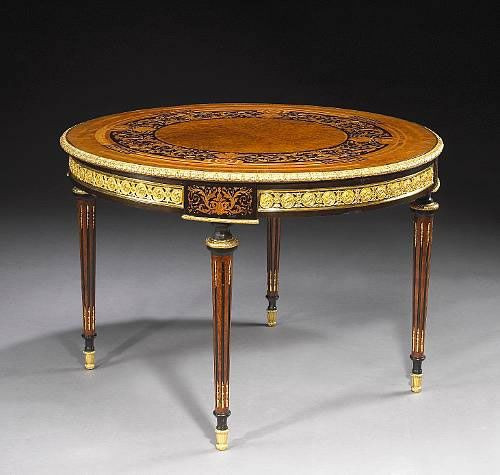A Very Fine French 19th Century Louis XVI Style Gilt-Bronze Mounted Tulipwood, Kingwood and Fruitwood Marquetry Circular Table. Attributed t...