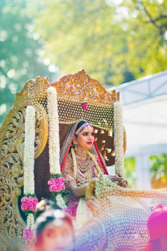 Bridal entry of south indian bride in palanquin