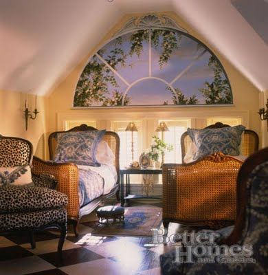 Gorgeous attic guest room. Love the faux window, the beds, the leopard chair