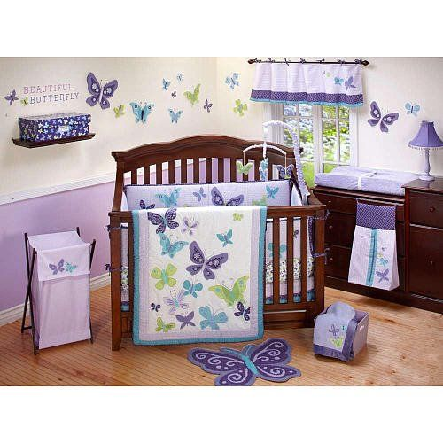 purple nursery with dark wood furniture