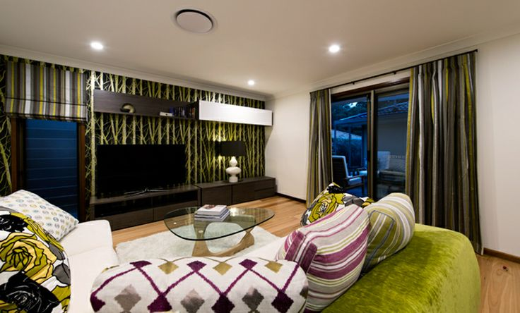 A media room becomes the hub of this home with its super comfortable sofa and smart decoration.
