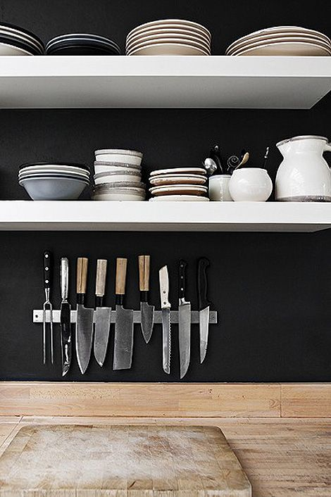 Open shelving in the kitchen again.  Also love the knife rack-- had one of these in my mum's kitchen growing up.Dark Wall, Black Wall