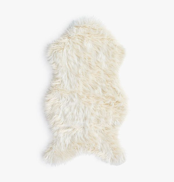 This faux sheepskin rug is incredibly soft and feels warm in winter and cool in summer. A stylish accent to any room!