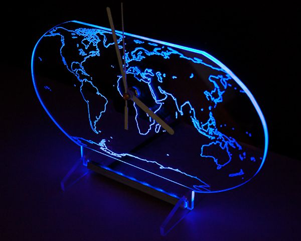 Clock with blue backlight LED in the shape of the globe. New design.