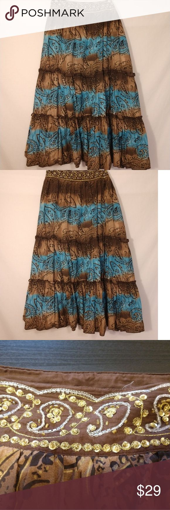 """Earth Tone Boho Gypsy Skirt w/ Bling Waistband Earth Tone Boho Gypsy Skirt w/ Bling Waistband  This skirt is absolutely beautiful!! All beading and sequins are intact. In like new condition!! EUC!!   Measurements: waist - 21"""" flat (42"""" around), length- 34""""   I ship all sales within 24 hours!!  Bundle and save 💵💵 Metro 7 Skirts A-Line or Full"""