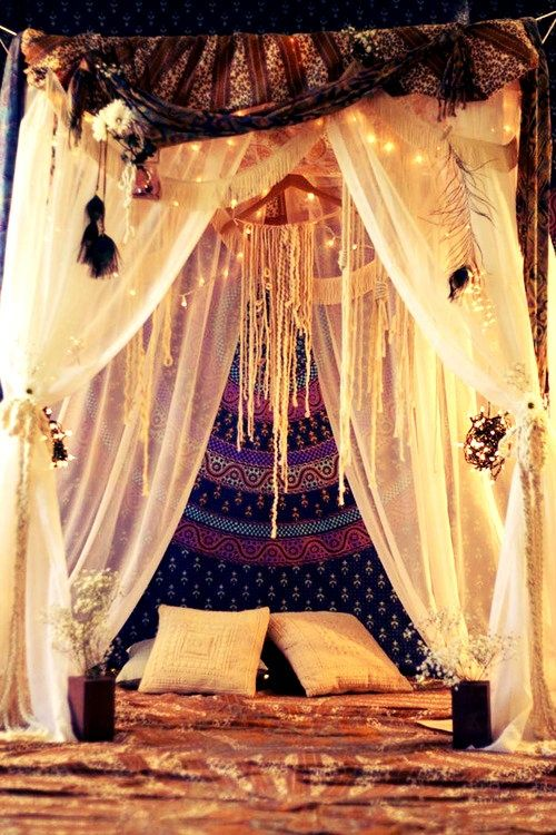 Dream catching bed - put a pole across the ceiling above the bed and hang drapes, dangling a big dream catcher in between above the head of the bed - cosy and very cool - also love the purple hanging behind