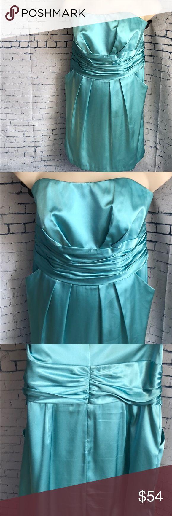 David's Bridal Aqua Bridesmaid Dress Like new Davids Bridal aqua polyester strapless bridesmaid dress.  A size 16 with details that make it figure flattering and side pockets for comfort. Davids Bridal Dresses Prom