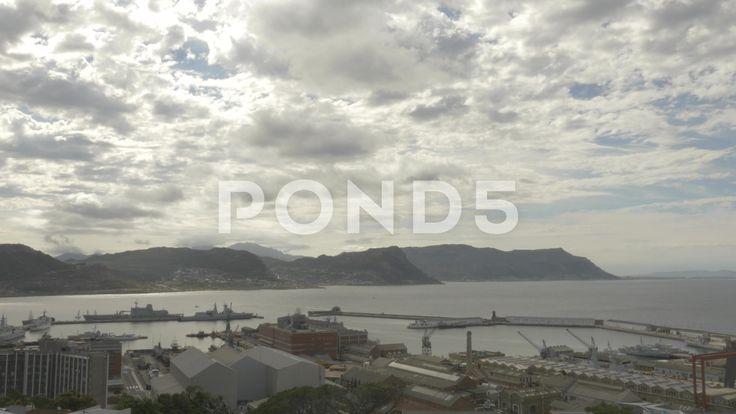 4k Wide Shot Naval Dockyard Pier Ocean Mountains In Background Cloudy Sky - Stock Footage | by RyanJonesFilms