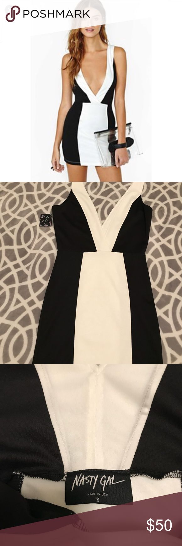 Nasty Gal Bond Dress NWT Nast Gal Bond Dress. Black and White mini fitted dress with extreme plunging bust front. Bought this dress and turned out to be too small. It's a Women's small but runs like an extra small. This dress has been sold out. Super excited for anyone who decides to buy this hot dress! Nasty Gal Dresses Mini