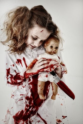 Ah... almost too creepy!!  Creepy little bloody girl with doll