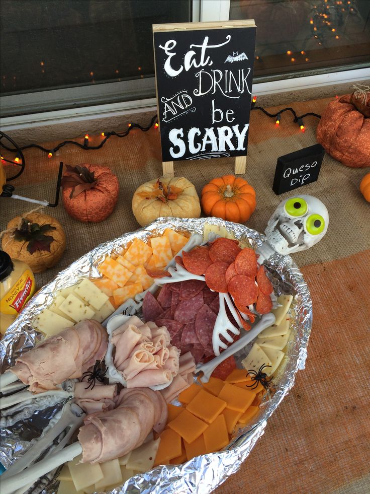 Dead meat. Halloween deli meat and cheese platter. Skeleton purchased from the party store decorated with various deli meats (salami, turkey, ham, pepperoni and assorted cheese). I used gummy eyeballs and displayed on a foul wrapped platter for a Halloween themed costume party - creepy but fun!