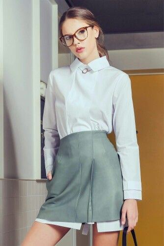 Andra Andreescu mint leather skirt & white shirt