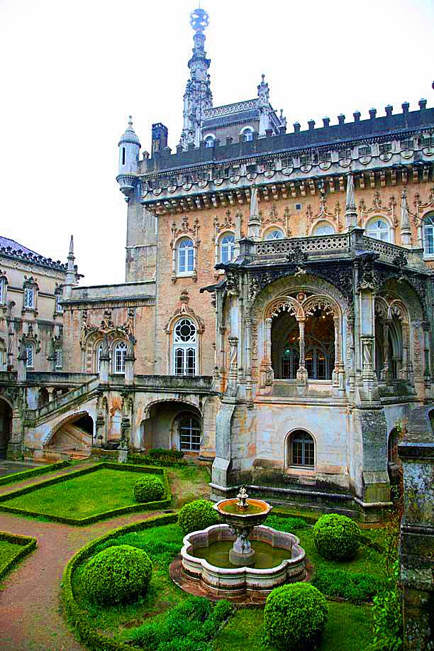 Bucaco Palace in Portugal - is typical Manueline style. Completed in 1907 as the summer palace of Carlos I, its role was short lived as Carlos was assinated a year later bringing the monarchy in Portugal to an end.  It is built on the site of a Carmelite monastery and set in 250 acres of woodland.  It is now a hotel