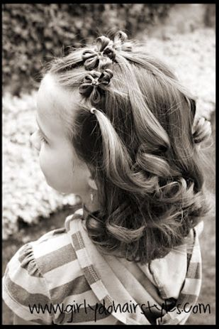 Flower Headband Hairstyle | 37 Creative Hairstyle Ideas For Little Girls http://www.girlydohairstyles.com/2012/05/flowers-in-hair-part-two.html