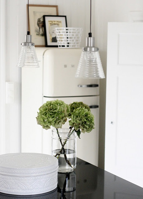 Interior Styling: Green flowers in jar / pendant lamps