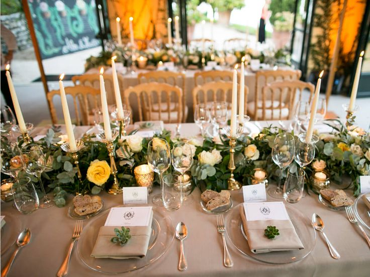Table design - long garlands decorate the centre of the tables and hang down to the floor