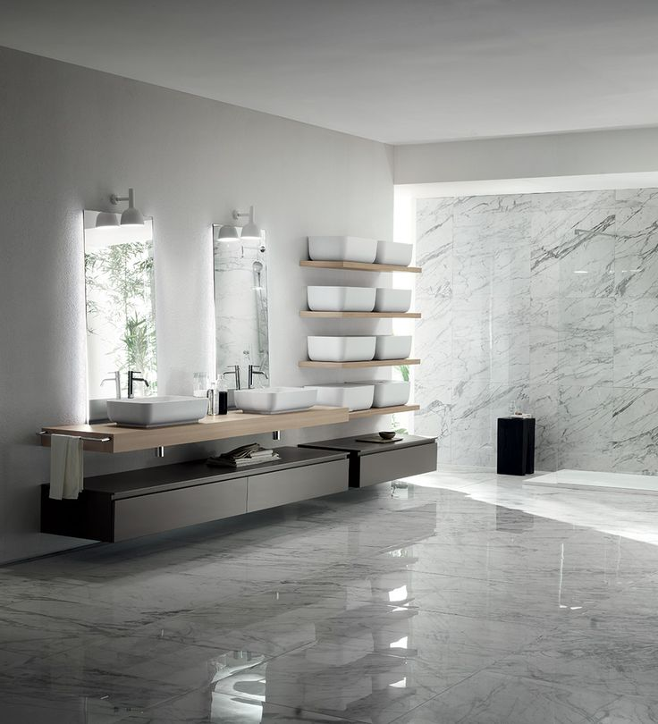 This composition features the Qi Cristalplant® washbasin in its sit-on configuration on the H.10 cm Hono Elm laminate top, which replicates the shape of the container, the distinguishing element of this model by Scavolini.