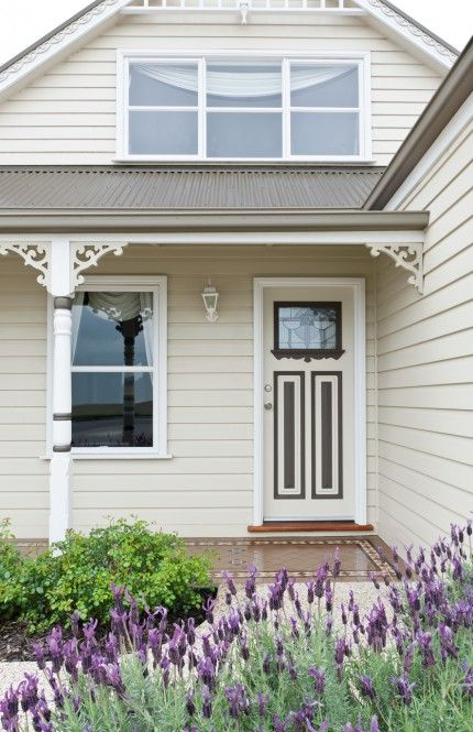 This federation exterior exudes old-time charm, enhanced by painting the intricate features of the front door in a darker neutral colour contrasting well the rest of the house. Colours are Berger Shaded Lane and Berger Cabinet Grey.