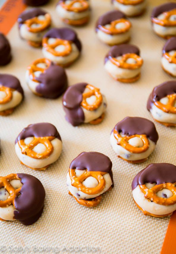 Cookie Dough Pretzel Bites. Safe-to-eat cookie dough stuffed between two salty pretzels. These bites are addicting!  No-bake & take no time at all!  Get the recipe at sallysbakingaddiction.com