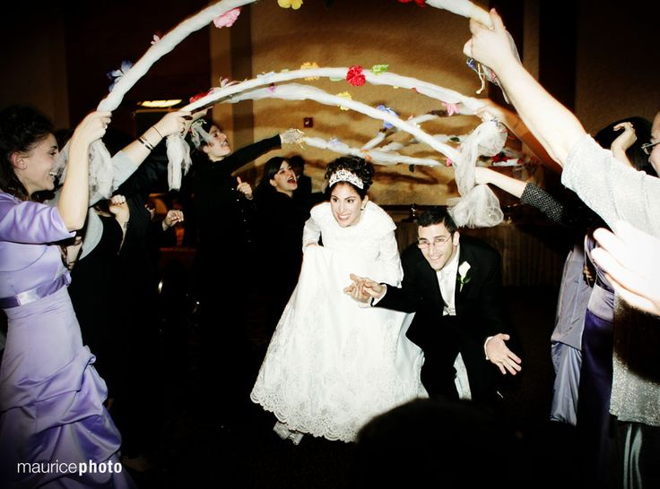 Husband and wife walk down the aisle at their wedding in the SeaTac Hilton in #SeattleSouthside. Photo by Maurice Photo